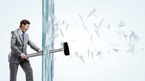 Man breaking glass Stock Images