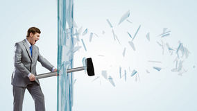 Man breaking glass Stock Photography