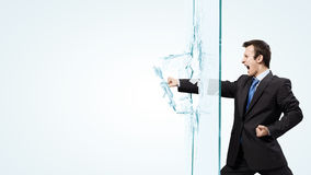 Man breaking glass Stock Photos