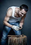 Man breaking his cell with hammer Royalty Free Stock Photo