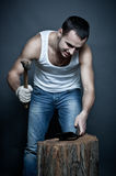 Man breaking his cell with hammer Royalty Free Stock Image