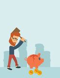 Man breaking piggy bank. A hipster Caucasian businessman standing while holding a hammer breaking piggy bank with dollar coins for financial assistance of his Stock Image