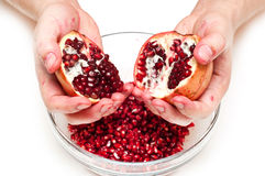 Man breaking pomegranate Stock Photography