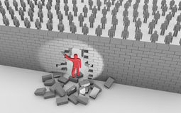Man breaking trough a wall Royalty Free Stock Photography