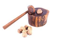 Man breaking a nut in a nutshell. Man breaking a walnut in a nutshell stock photo