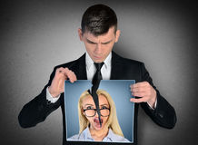 Man breaking woman picture Stock Photo