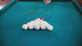 Man breaks balls in billiards stock video footage