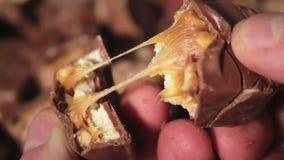 Man Breaks A Chocolate Bar