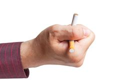 Man breaks a cigarette in his hand Royalty Free Stock Photos