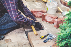 Man breaks masonry hammer and chisel Royalty Free Stock Images
