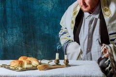 Homemade challah on Shabbat. A man breaks Saturday& x27;s festive bread Homemade challah on Shabbat Royalty Free Stock Image