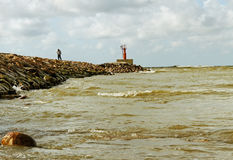 Man on the breakwater. Royalty Free Stock Photos