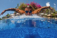Man breath while swim. Face of swimming man in pool blue water close up Stock Photography