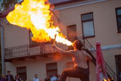 Man breathes fire in a public place stock images