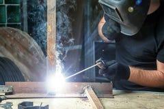 Man brewing a metal welding machine Stock Photo