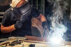Man brewing a metal welding machine Royalty Free Stock Image