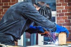 Man brewing a metal welding machine royalty free stock photo