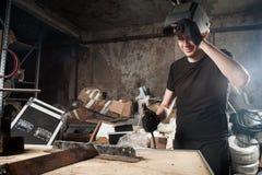 Man  brews a metal Royalty Free Stock Images