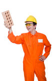 Man with brick isolated Royalty Free Stock Photo