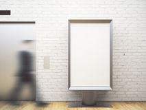 Man in brick room with poster. Blurry view of blurry businessman walking in brick interior with elevator and empty white poster. Mock up, 3D Rendering Stock Photo