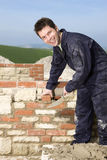Man bricklaying wall with trowel Stock Photography