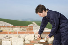 Man bricklaying wall with trowel Royalty Free Stock Photo