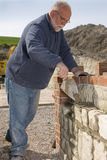 Man bricklaying wall with trowel Royalty Free Stock Images