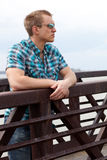 Man on Bridge Royalty Free Stock Photography