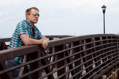 Man on Bridge Stock Photography