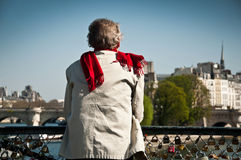 Man on the Bridge of Arts in Paris royalty free stock photography