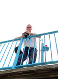 Man on bridge with camera. Photo of a man on bridge with camera and photographic equipment Royalty Free Stock Image