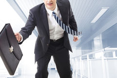 Man with briefcase Stock Images