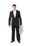 A man with a briefcase in his hands standing Royalty Free Stock Images