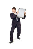 A man with a briefcase in his hands standing Stock Image