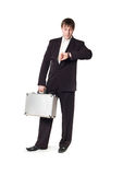 A man with a briefcase looking at his watch Stock Images
