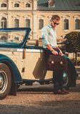 Man with briefcase near classic convertible Royalty Free Stock Photos