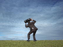 Man with briefcase over head Stock Photography