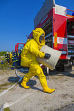 Man with briefcase in protective hazmat suit stock image