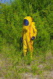 Man with briefcase in protective hazmat suit Royalty Free Stock Photos