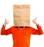 Man in bright clothes with a paper bag on head, Royalty Free Stock Photography