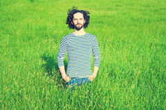 Man in bright grass Royalty Free Stock Images