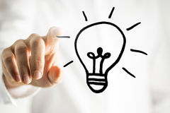 Man with a bright idea - a light bulb Stock Images