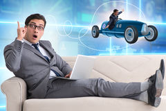 The man with bright idea sitting on sofa Stock Image
