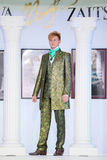 Man in bright suit on show of designer  Slava Zaitsev Stock Images