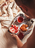 Man bring breakfast in bed Royalty Free Stock Photography