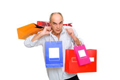Man  bring  paperbags. Mature man  bring a lot of color  paperbags isolated on white Stock Photography