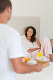 Man bringing the breakfast to his wife Stock Photos