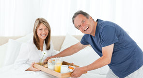 Man bringing breakfast to his wife Royalty Free Stock Photos