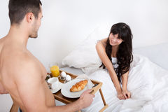 Man bringing breakfast to his wife Stock Photography