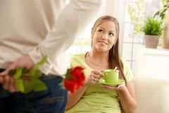 Man bringing flower to woman Royalty Free Stock Image